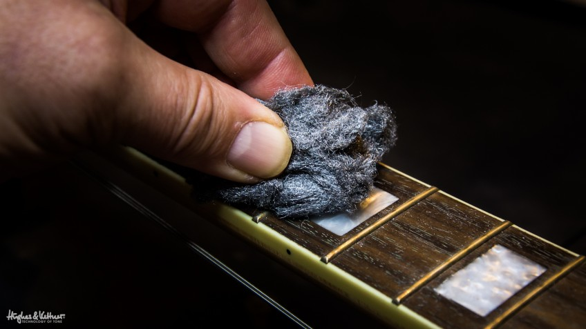 Easy does it with the steel wool: use only the finest grades (0000 is the standard choice) and go with the grain of your fingerboard to avoid scratching the wood. You can also use steel wool to buff the frets themselves if they've become tarnished or corroded.