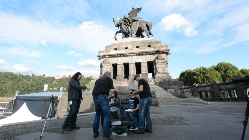 Getting Alan Parsons set up for his interview before the band's gig at the Deutsches Eck in Koblenz, Germany. The stage area is the black tent in the bottom left of the photo. And yes, we carried the Hughes & Kettner couch up about 100 steps to get this location!