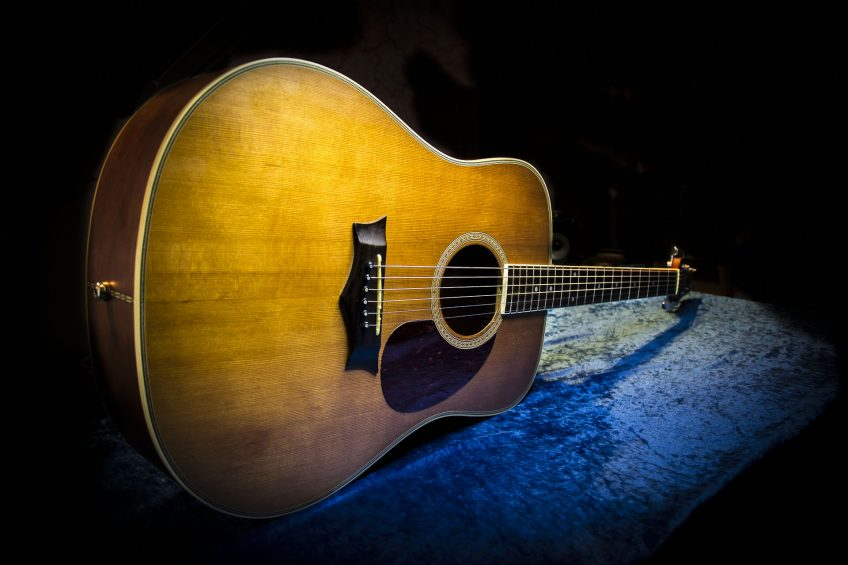 What a beauty! All you need to do is look at this acoustic guitar (actually an old, inexpensive Peavey model with a wonderfully resonant - and photogenic - cedar top) to get inspired to play music.