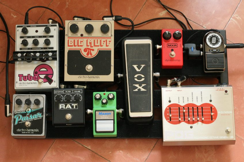 A few racket-making classics on this board: the Rat and the Big Muff, to name but two... (Photo by Michael Morel, used according to the Creative Commons Attribution 2.0 Generic license. Original image here: https://commons.wikimedia.org/wiki/File:Pedalboard_(995939579).jpg)