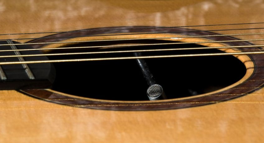 Spot the sneaky built-in microphone under this guitar's soundhole pickup!
